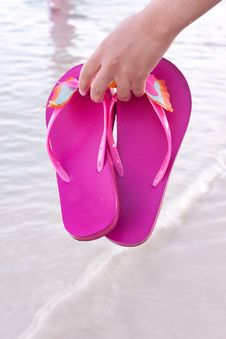 Young Woman On The Beach With Flip Flop Royalty Free Stock Image