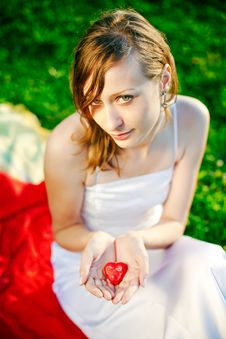 Woman Giving Her Heart Stock Image