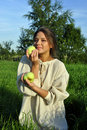 Free Girl In A Linen Shirt, Holding Apples Royalty Free Stock Photos - 21022258