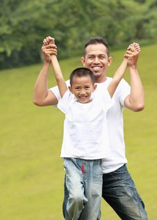 Man And Young Boy Playing Stock Photos