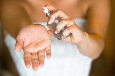 Bride Spraying Perfume Royalty Free Stock Photography