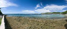Panorama Sand Beach On Rocky Coast Line Stock Photography