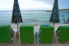 Free Beach Chair And Colorful Umbrella Stock Images - 21025934