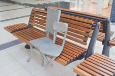Sculpture Of Two Chairs In Shopping Mall Stock Image
