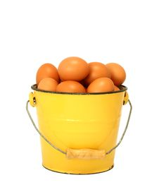 Eggs In Yellow Old Metal Bucket Isolated On White Stock Photo