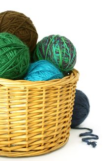 Wool Balls In A Wattled Basket  On White Royalty Free Stock Photos