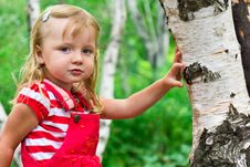 Beautiful Girl Near The Tree Royalty Free Stock Photos