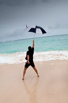 Free Tanned Man Jump With Umbrella In Blue Sea Stock Photography - 21033542
