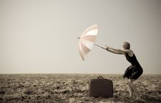 Free Redhead Girl With Umbrella At Windy Field. Royalty Free Stock Image - 21035096