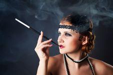 Smoking Retro-styled Sexy Lady Stock Image