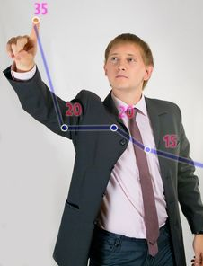 Free The Young Man In A Suit Shows The Schedule Royalty Free Stock Photos - 21041378