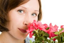 Free Girl Smelling A Flower. Royalty Free Stock Images - 21044869