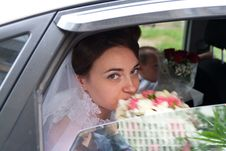 Free Beautiful Bride Looking Out From Car Window Royalty Free Stock Photography - 21046457