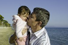 Free Baby With Her Father On The Beach Royalty Free Stock Image - 21047306