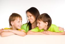 Mom With Kids On Sofa Stock Image
