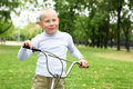 Free Boy On A Bicycle In The Green Park Royalty Free Stock Photos - 21055628