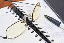 Open Notebook And Pen On The Table Royalty Free Stock Image