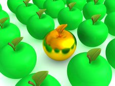 Golden Apple Among Green Apples Royalty Free Stock Photography