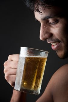 Indian Man Drinking Beer  From Beer Mug Royalty Free Stock Images