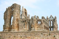 Free Abbey Ruins Behind Wall Stock Photos - 21054003