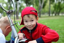 Free Boy On A Bicycle In The Green Park Stock Images - 21055614