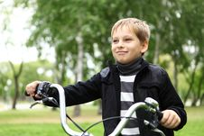 Free Boy On A Bicycle In The Green Park Stock Photos - 21055623