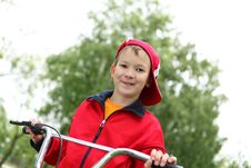 Free Boy On A Bicycle In The Green Park Royalty Free Stock Photo - 21055645