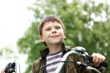 Free Boy On A Bicycle In The Green Park Stock Photography - 21055652