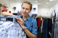 Free Young Girl Buying Clothes Stock Photo - 21055690