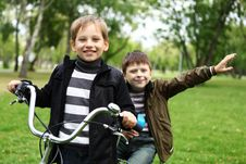 Free Boy On A Bicycle In The Green Park Royalty Free Stock Image - 21055696