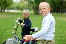 Free Boy On A Bicycle In The Green Park Royalty Free Stock Photography - 21055697