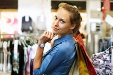 Free Young Girl Buying Clothes Stock Photography - 21055702
