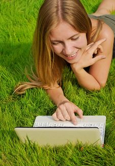 Free Girl On Lawn Working On Laptop Royalty Free Stock Image - 21059596