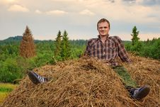 Free Guy On Hay Stock Image - 21059691