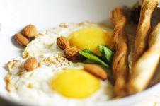 Free Fried Eggs, Almonds And Salty Crackers Stock Image - 21059741