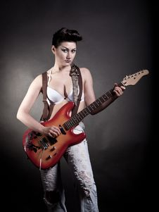Sexy Girl With A Guitar Playing Rock Royalty Free Stock Image