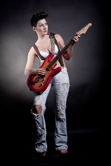 Sexy Girl With A Guitar Playing Rock Stock Photography