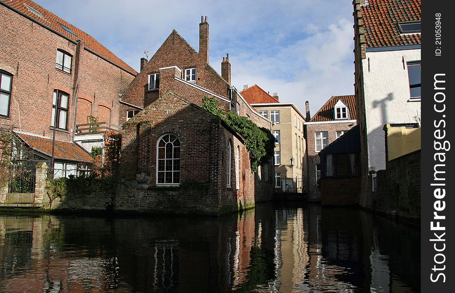 Reflected Bruges houses, canal view
