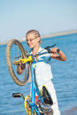 Free Beautiful Young Girl Standing With Her Bicycle Stock Image - 21060481