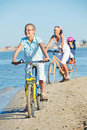 Free Cute Girl With Her Mother And Brother Ride Bikes Royalty Free Stock Image - 21061856