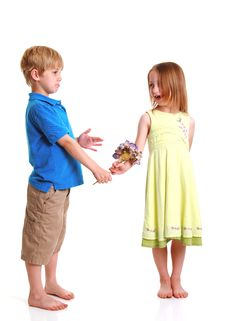 Young Boy Giving Young Girl Flowers
