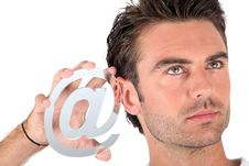 Free Man Holding An @ Sign Royalty Free Stock Images - 21065409