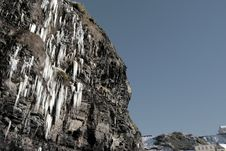 Cascade Of Icicles Thaw On A Cliff Face Stock Photo