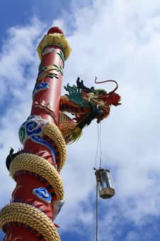 Free Dragon Statue On The Red Column Stock Image - 21066231