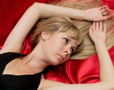 Free Portrait Girl Lying On A Red Background Royalty Free Stock Photography - 21066507