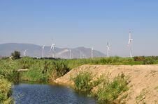 Free Wind Turbines Near Creek Stock Photos - 21073903