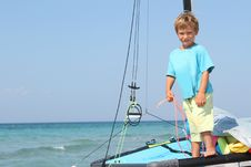 Free Boy On Board Of Sea Catamaran Royalty Free Stock Photos - 21076208