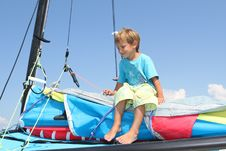 Free Boy On Board Of Sea Catamaran Royalty Free Stock Photos - 21076228