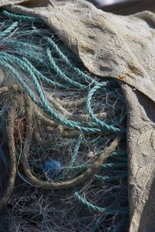 A Pile Of Fishingnets And Ropes Covered Royalty Free Stock Photos