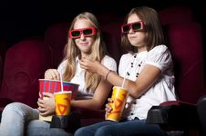 Free Two Beautiful Girls Watching A Movie At The Cinema Stock Photography - 21081102